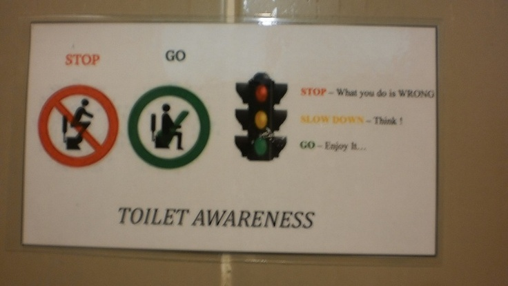"""""""toilet awareness - Stop. Think. Enjoy""""    Sign in the KL airport toilet cubicles"""