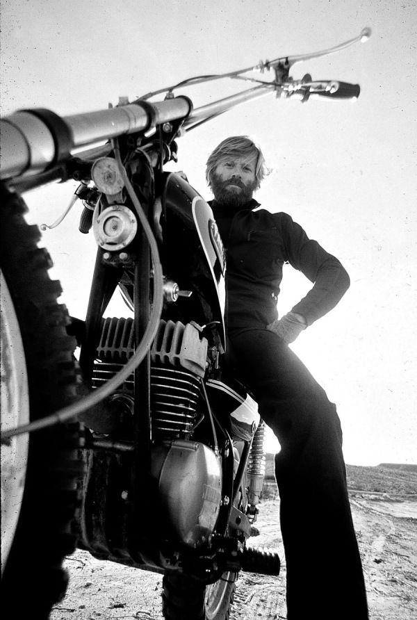 ca. 1972 — Robert Redford, looking very Jeremiah Johnson here, on his Yamaha dirt bike — Image by Orlando Globey
