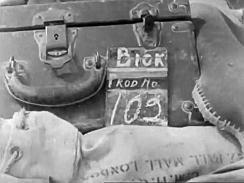 """Sergeant J. """"Joe"""" Bickerdyke. Bickerdyke also came from Hollywood and enlisted before the USA officially entered the war. Note the case for the camera and the mailbag for the exposed rolls of film addressed 27-28 Pall Mall, London."""