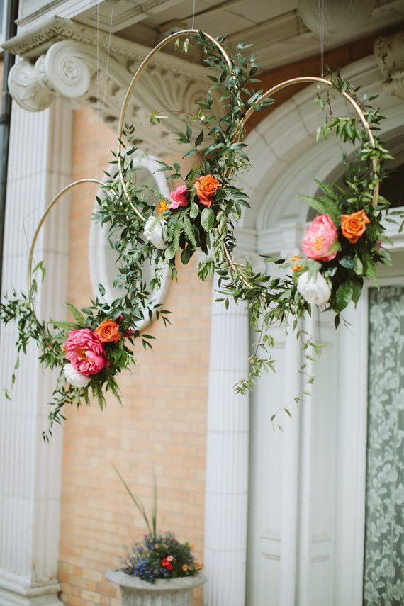Gold hoops with flowers. Seriously, how stylish can a wedding get?! Photo: Paige Jones Photography