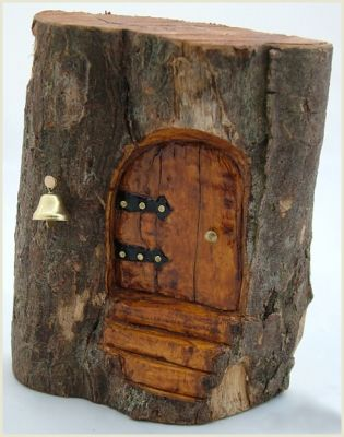 I love the metal work on the door. Great fairy home. Posted on Fae Nation.