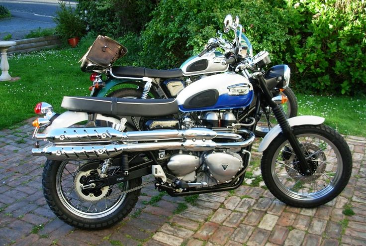 The Triumph Scrambler and Triumph Bonneville wait anxiously to find out which one will go on the next road trip.