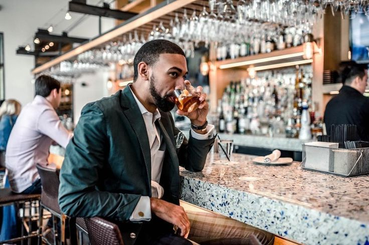 Fashion blogger Sir Josh Aaron sips his fav cocktail over some Chivalry Blue Vetrazzo glass counters at Caracol Restaurant in Houston, TX.