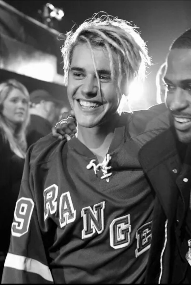 Justin shows his sweet smile.