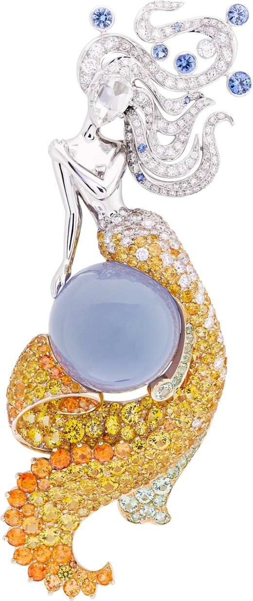 Van Cleef & Arpels ~ The 'Seven Seas' Collection 'Fairy of Sea' clip. Inspired by the Indian and Atlantic Oceans, the clip is set with diamonds, blue and yellow sapphires, spessartite and grossular garnets and a 23.64-carat cabochon chalcedony in white and yellow gold. 2015. V