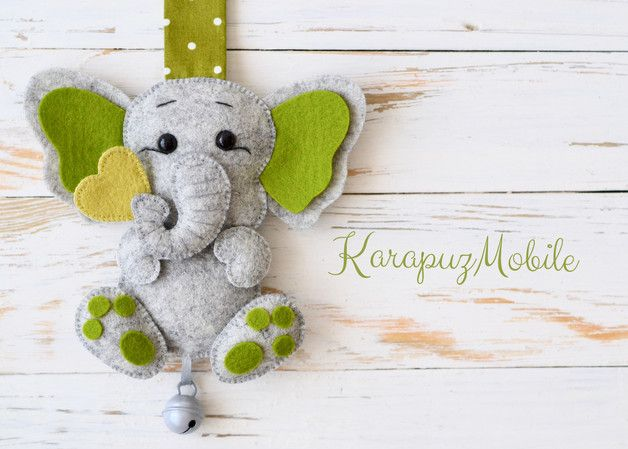 Elephant in grau-türkis.  Niedlicher Anhänger für Kinderwagen aus 100% reinem Design Wollfilz. Der Anhänger ist auch als Dekoration für Kinderzimmer, Babywiege usw. geeignet. Man kann ihn mit...