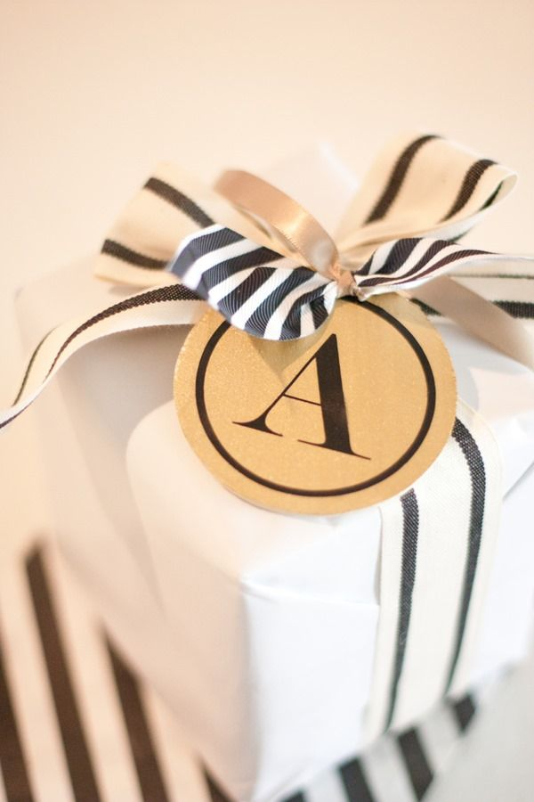 Plain paper, striking ribbon--no need for a variety of wrapping paper, just celebration-appropriate tags or cards/envelopes.