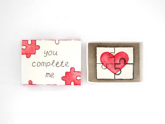 You complete me, matchbox card, love mail, love card, puzzle card, matchbox art, message box, perfect piece, boyfriend girlfriend gift  Send a unique love card with this matchbox! The cover has the phrase you complete me and on the inside is a puzzle with red heart. The puzzle and the piece are glued in two different heights to create a 3d effect. The matchbox and its cover are hand folded, glued and hand painted. size: 5.5x4x1.3 cm (2.1x1.57x0.5 in) for the matchbox  **** MADE TO ORDER…