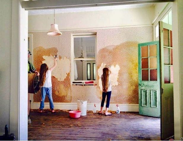 Putting the children to work, stripping wallpaper in the entry way...