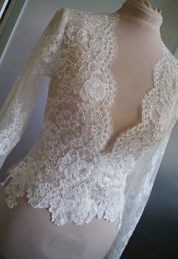 Unique beautiful wedding jacket-bolero.  color :  1. ivory  2. white  Bolero made with lace. Lace is hand-cut .Fastened at the front   Long sleeve -60