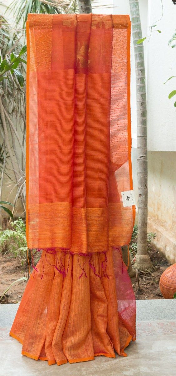CAPTIVATING ORANGE IRIDESCENT PINK HALF AND HALF BAILOU MATKA SILK HAS ORANGE SEQUINED BORDER. THE ORANGE WITH PINK PALLU GIVES THE SAREE DAZZLING LOOK.