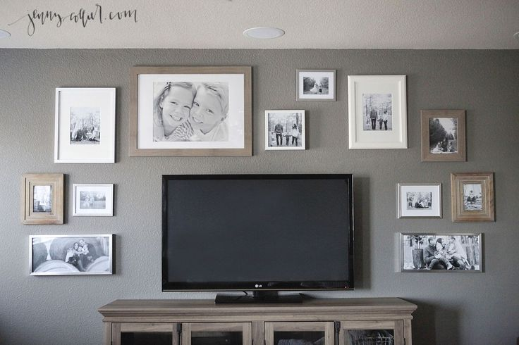 How to create a gallery wall surrounding TV by finding inspiration, using pieces of paper to arrange, and picture hanging strips.
