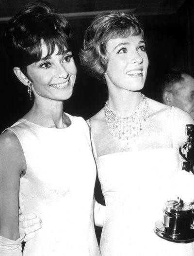 "Audrey Hepburn and Julie Andrews, 1964 - Julie Andrews was turned down for my fair lady as she didn't have the look they were going for. That same year she won the Oscar for ""poppins."" Sadly, Audrey Hepburn who they did cast in My Fair Lady did not get to sing her own part as she didn't have the voice they were looking for. Oh old Hollywood."