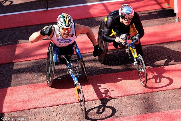 Close: Australias Kurt Fearnley won the race by a split second from Switzerlands Marcel Hug