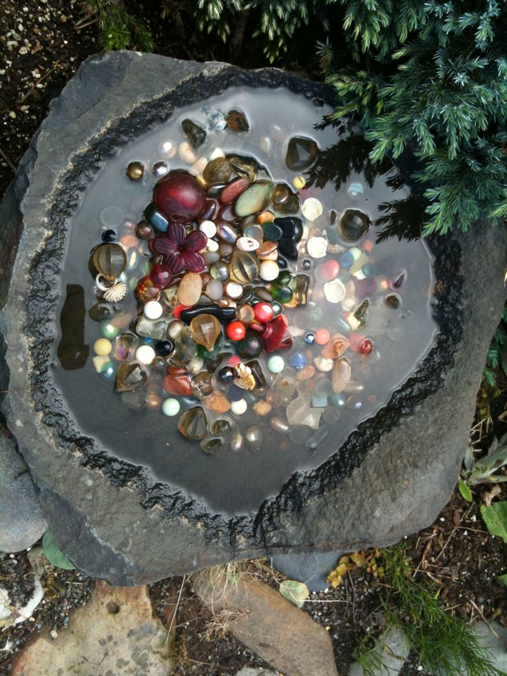 Gems, marbles and more in a water bowl. Add a splash of color to shade. This is also great for Honey Bees and other pollinators to get a fresh drink.