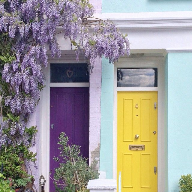 good neighbors, one painted the door purple, the other painted the door gold, in London