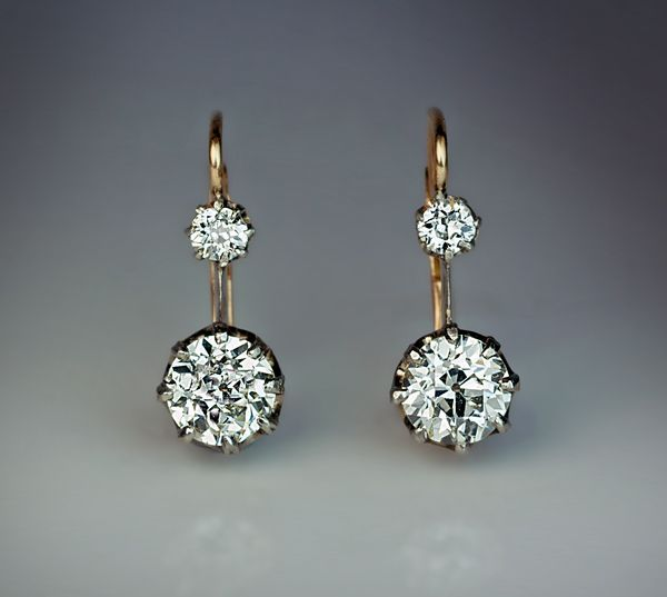 Vintage Two Stone Diamond Earrings circa 1910 The silver topped 14K gold leverback earrings are prong-set with four sparkling old European cut diamonds: 0.