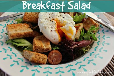 Great way to start your day ... salad greens, some sausages and croutons topped with a perfectly poached egg.