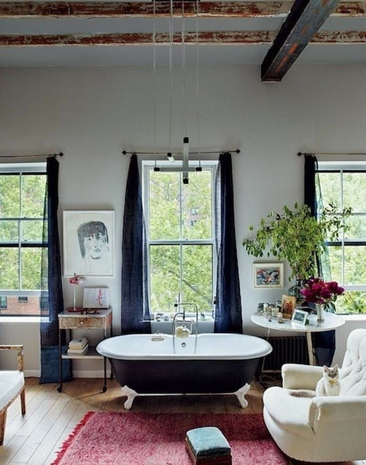 Vogue understands that a boho bathroom is equal parts powder room and living room. Don't be afraid to bring a comfy chair or a dresser into this space to give it a laid-back, lived-in vibe.