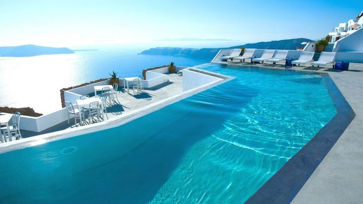 swimming pool Swimming Pools Inspiration Ideas With Outdoor Coffee Table And Sun Loungers Also Sea View How to Determine the Great Pool Builders