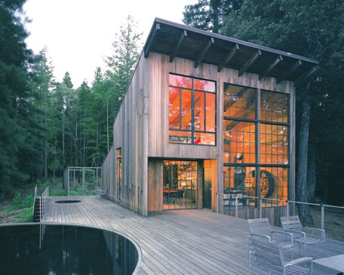 Dreamy. Love the windows, beams, furniture and sleek deck and railing