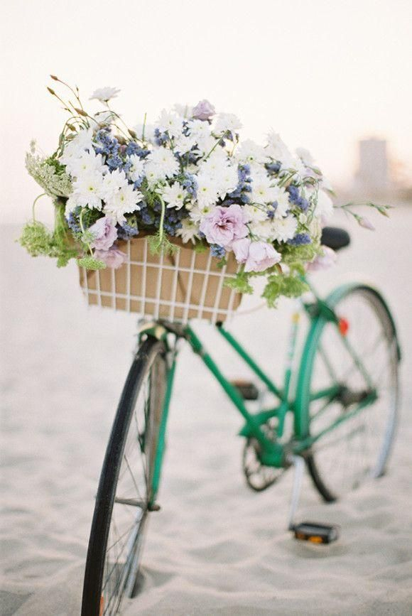 Green bike with flowers.