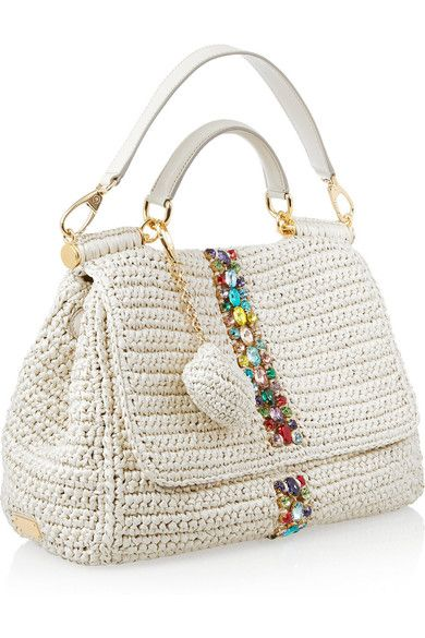 Off-white raffia Cream leather (Calf) top handle and detachable strap Multicolored crystal embellishment through front, detachable raffia coin purse, adjustable snap-fastening sides, gold hardware Internal zip-fastening and pouch pocket Fully lined in leopard-print twill Double magnetic fastenings at flap front Comes with dust bag