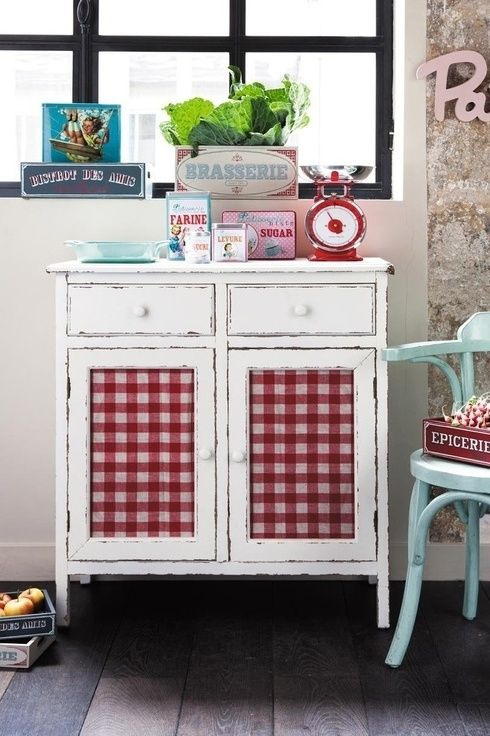 Such a sweet idea- think of all the different fabric you can use for this and set the tone of the room! Here it's: gingham-fronted vintage dresser