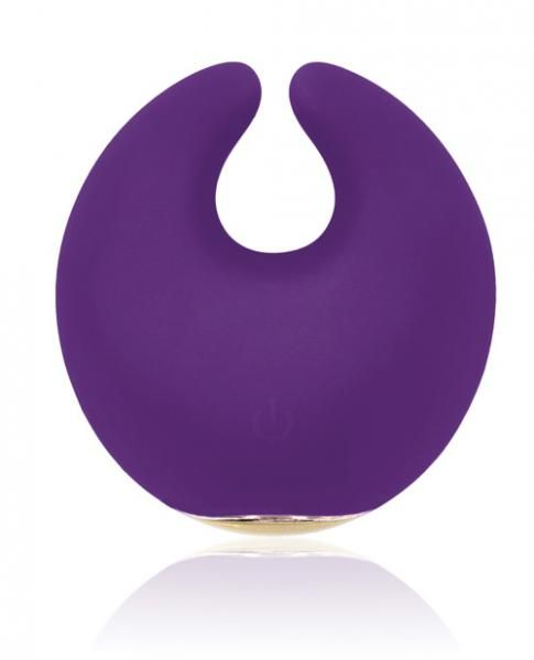 Feel moon struck with this extraordinary clitoral massager by RIANNE S. This rechargeable moon shaped massager is made of medical grade soft silicone and has 2 powerful motors, providing you with 3 different intensities and 4 speeds. The vibe is finished off with a Champagne gold colored trim and comes with a luxury cosmetic bag to store your vibe and beauty accessories. 100 percent waterproof. USB rechargeable. By Rianne S.