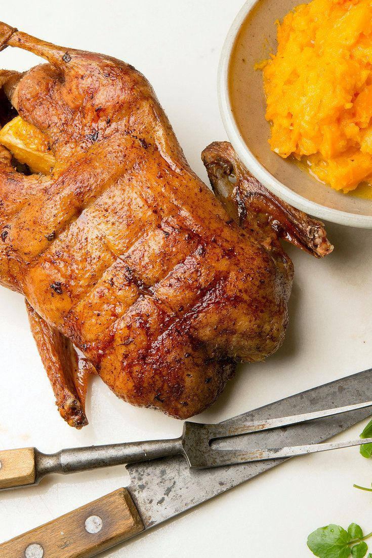 NYT Cooking: For a festive occasion, a burnished whole duck makes quite an impression — fancier than chicken and more elegant than turkey. Roasting the duck is not so difficult to do, but it can be smoky; to be on the safe side, dismantle your smoke alarm and turn on a good exhaust fan. (If your oven has a convection fan, don't use it; that way you avoid unnec...