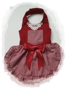 1-This is a beautiful dog dress that is fancy and yet comfortable for your pet. its a dark red satin with a double skirt with black lace. The 2 black bows are accentuated with rhinestones. Perfect for the holidays or as a saloon girl pet costume! 2- A red gingham dress with ruffles. A pocket is up top with a pretty collar. Little Red Riding Hood style. These are made to order so I will need measurements. If youre not sure how to measure, please contact me before placing an order. See the…