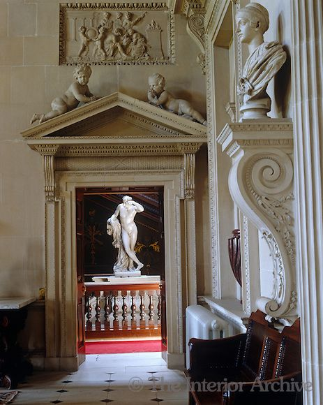Houghton Hall ~ A pair of cherubs pose on top of a pediment above a doorway in the Stone Hall leading to the Great Staircase
