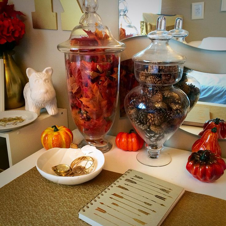 Apothecary jars decorated for fall.