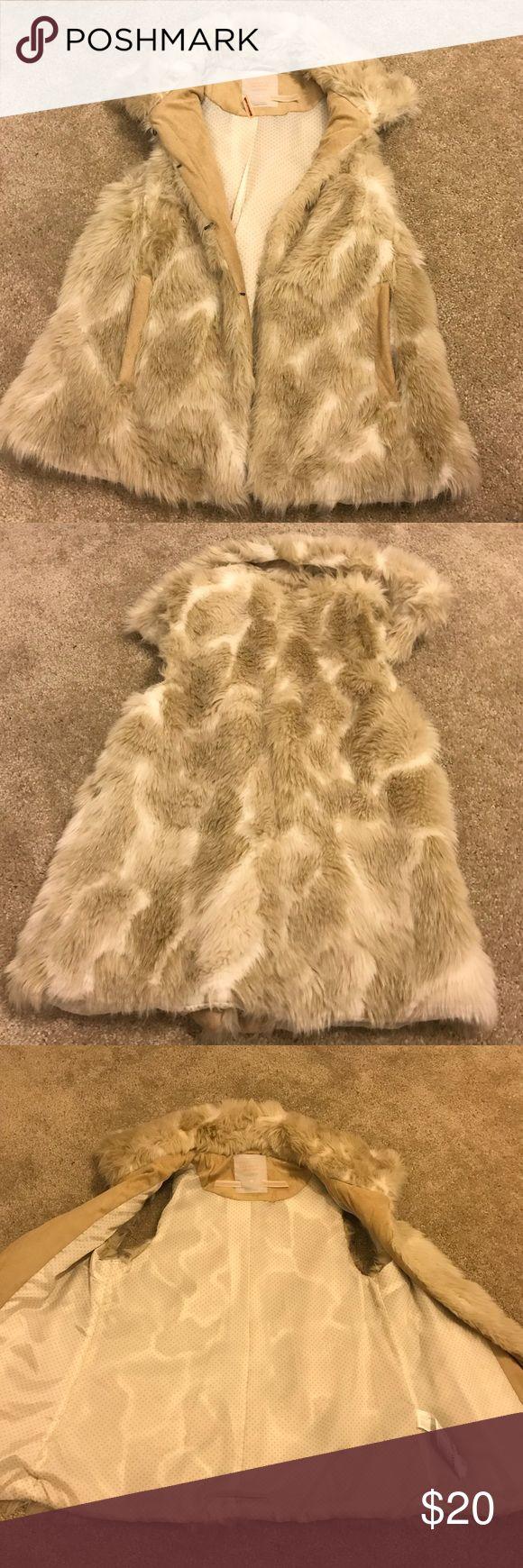 Tan Fur Vest Tan Fur Vest. Like new. Smoke & Pet Free Home. Sizing says (EUR: L/ MEX: 30) I would say its an XS or S ( run small) Bershka Jackets & Coats Vests