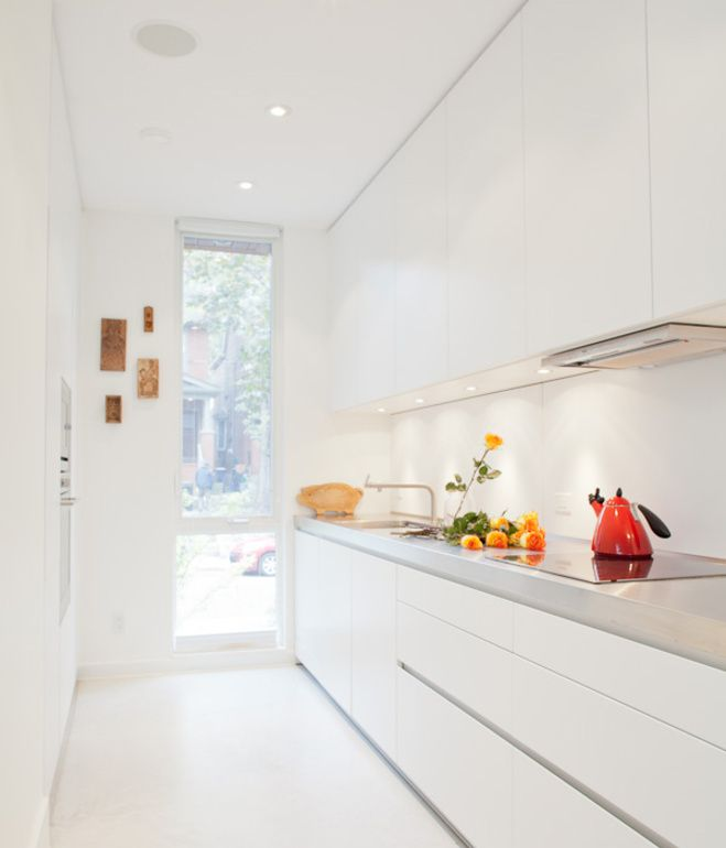 The galley kitchen, in classic white, is the one splurge within the interior: it was custom made by Bulthaup from their B1 series. A narr...