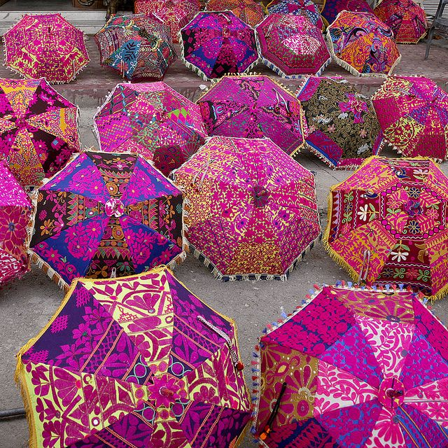 Some of these Indian umbrellas, inspired by the 'Spirit-of-the-Holi-Colors,' with very colorful designs-patterns may just be unique to India.