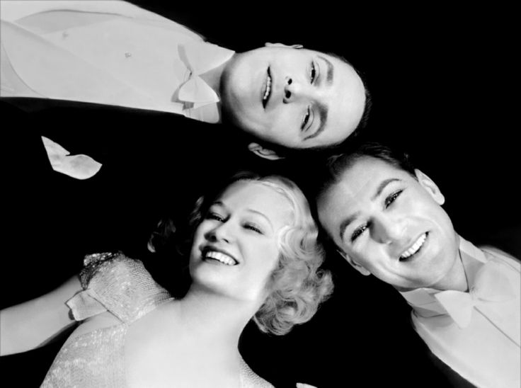 """Miriam Hopkins, with actors Gary Cooper and Frederic March, in Ernst Lubitsch's film, """"Design For Living,"""" 1933."""