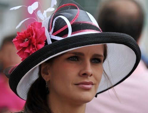 A woman sports a fancy hat before the start of the Kentucky Oaks at Churchill Downs in Louisville, Ky