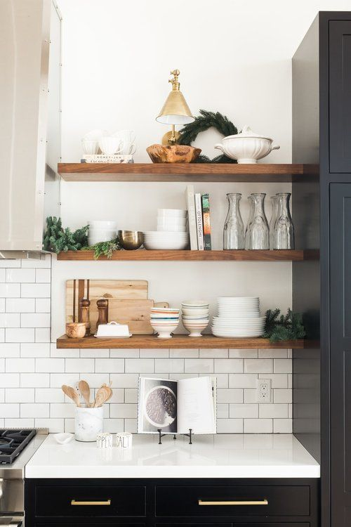 A cute area in the kitchen for some fresh air! Rad floating shelves create an open space that allow the walls to breathe and can get the creative juices flowing!