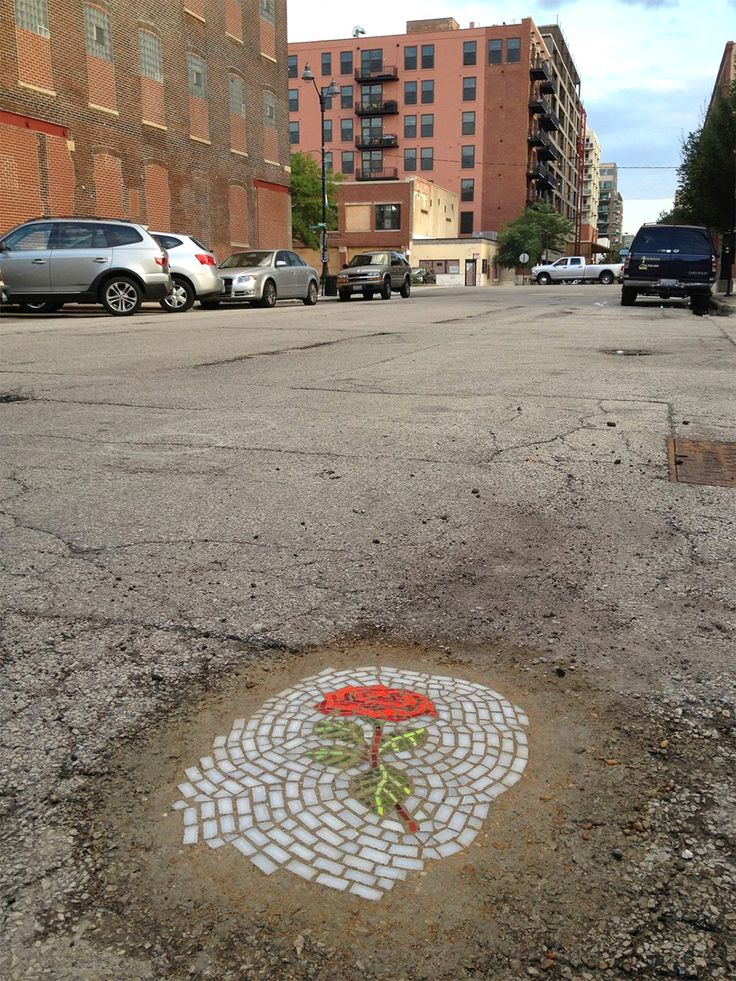 Artist Jim Bachor (previously) continued his guerilla effort to remedy Chicago's pothole problem by creating a number of flower mosaics in streets around the city. Bachor installed four mosaics through this fall while the weather cooperated, but as things get wet and cooler we'll probably see a bit less of his, uhm, street art. I'm not sure if any of these are still around, but he keeps a list of photos and addresses where each piece was installed.