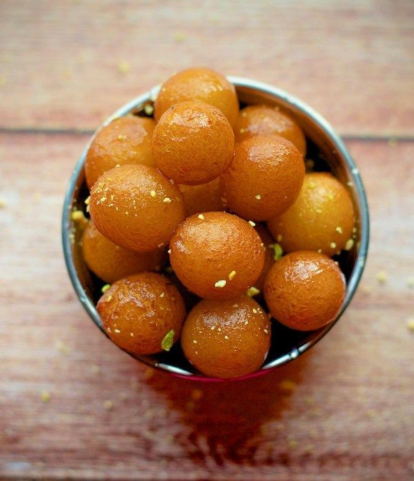 India's most beloved dessert and a favorite at Indian buffets ! Here's an easy and fail-proof recipe to make these melt-in-the mouth Gulab Jamuns at home.