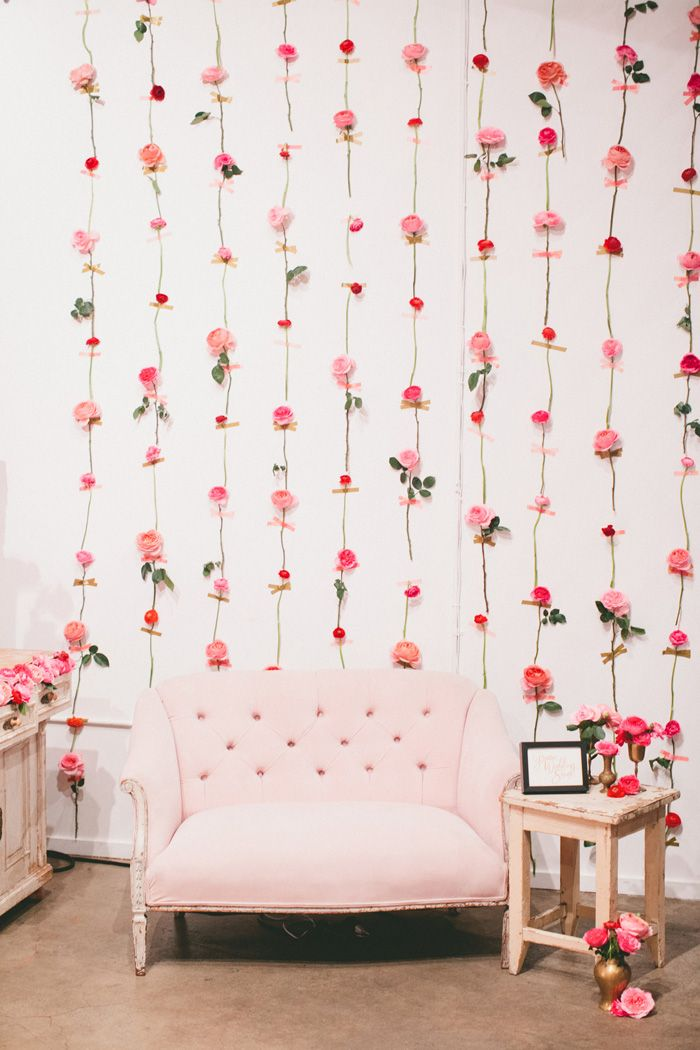 Possibility for photobooth backdrop: Get white dry wall and put flowers on it for photobooth backdrop  Photo booth with a rosy backdrop.