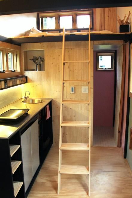 A ship's ladder (which can be stored in the living area when not in use) leads to the 6' x 7' sleeping loft.
