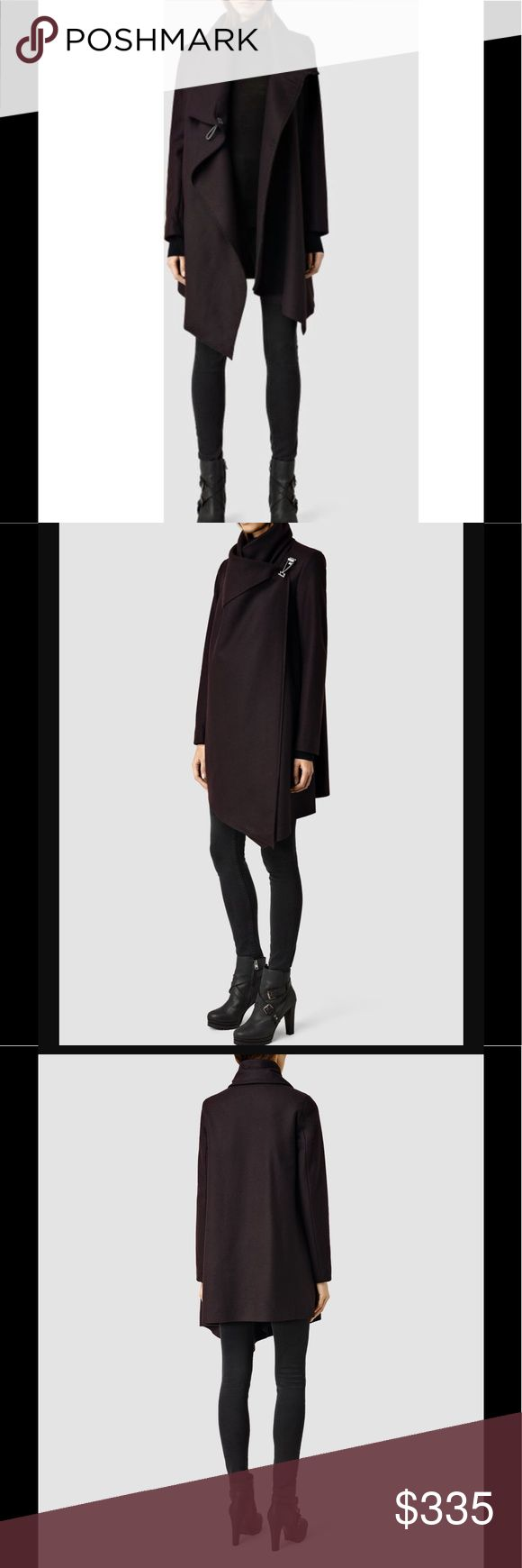 All Saints City Monument coat oxblood US 00 4 This iconic All Saints Spitalfields crafted from Italian wool is the ultimate chic fall and winter coat. The shape is modern and cool but still classic enough to wear through the cold season. The quality wool is tightly woven to keep out the cold but made from a lightweight Italian wool which allows for enough drape for a flattering fit, hook finish and the swingy cut which will allow for a range of sizing. Subtle slash pockets and interior…