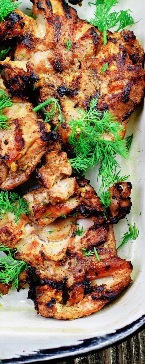 Mediterranean Grilled Chicken + Dill Greek Yogurt Sauce! The perfect grill recipe! Chicken thighs marinated in Mediterranean spices, garlic, lemon and olive oil sauce. Grills perfectly in 15 minutes! Every bite with a dollop of the dill yogurt sauce is simply bliss!