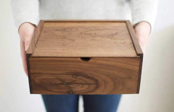 Our world map, walnut keepsake box, for holding onto and reminiscing about your most meaningful adventures. ____________________________________  DETAILS  • Black Walnut memory box with slide top lid • Engraved with World Map outline • 9.5(length) x 7.5 (width) x 4(height) • Precision hand-cut joinery • Reinforced with all natural hide glue • Finished with an organic wax for a low gloss, antique sheen ____________________________________  NOTE Every box is carefully handcrafted in our wood…