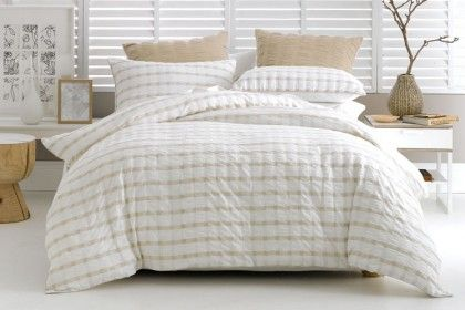 Deco Donovan Quilt Cover Set. The relaxed look and soft feel of cotton seersucker is an easy-to-live-with classic. This smart check features piping trim and a plain cotton reverse.