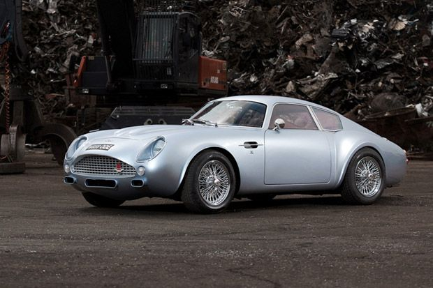 Aston Martin DB4 Zagato Carbon Fiber    What started as an Aston Martin DB7 Vantage, the reworked outer shell provides a sense of nostalgia while other changes include a reduced wheelbase, bespoke breaking and suspension systems, V12 engine and oxblood red hide interior. The supercar is currently being set for auction in Monaco for those of you with the budget and desire to add a little 007 flare to one's life.