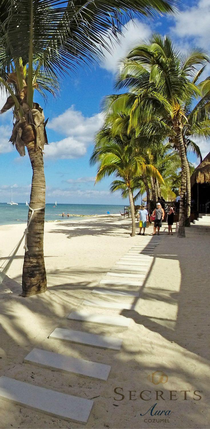 Soak in the sun poolside or on our sugar sand beach at Secrets Aura Cozumel.
