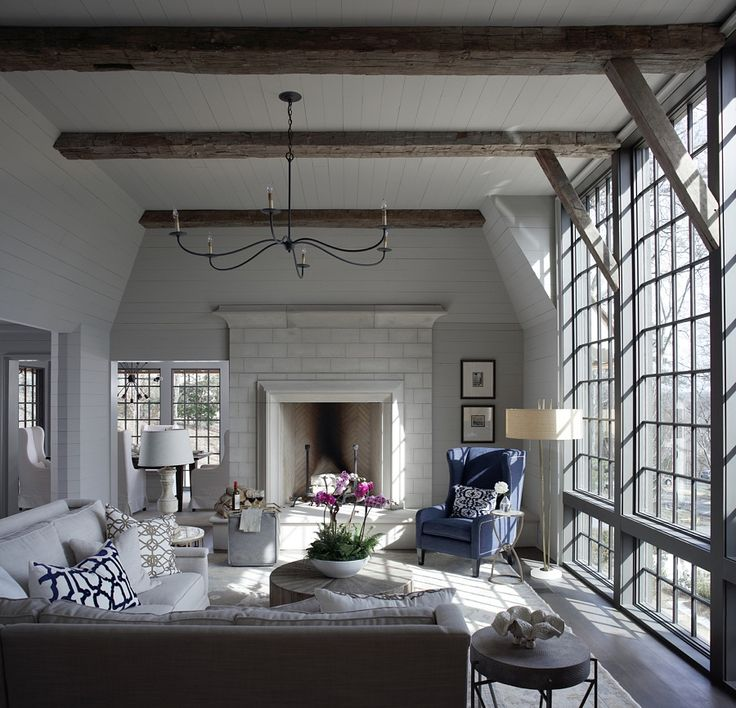 In this gracious keeping room, a wall of windows provides a seamless and calming union with nature.